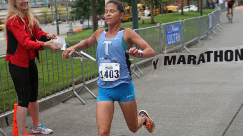 Kate Landau, shown at another race, kicked butt with the kiddies in the Portland 10K.
