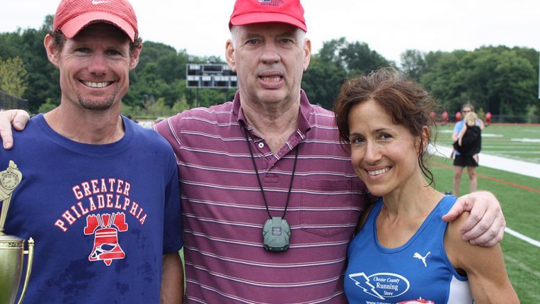 Peter Taylor posed with middle-distance greats Nick Berra and Lorraine Jasper after a 2013 meet.