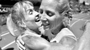 Lesley Hinz (left) hugs her friend Sue McDonald after Sue lowered her own W50 American record for the 800.
