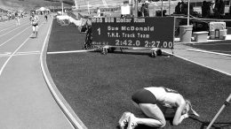 Sue McDonald recovers on infield after setting a W55 American record in the 800.