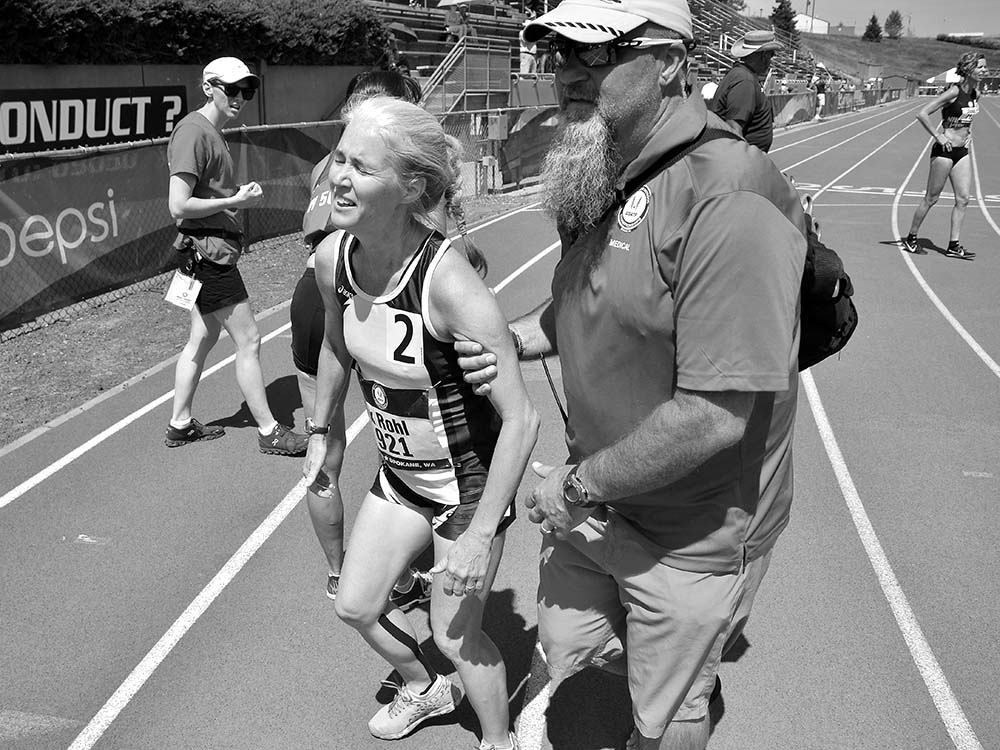 Three-time Olympic race walker Michelle Rohl, suffered from the heat at the end of her 800, but still won the W50 age group.