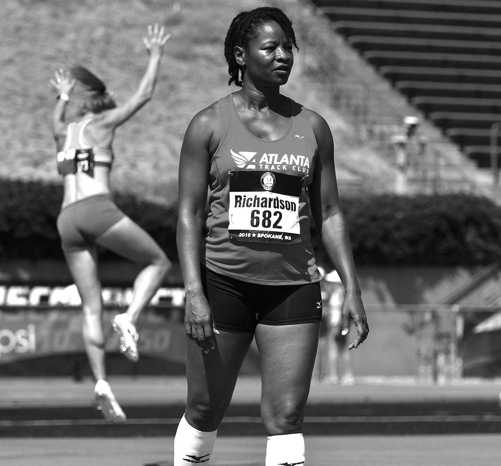 W50 Regina Richardson of Clayton, North Carolina, eyes the high jump bar as a rival warms up.