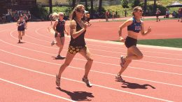 Iowa's Kay Glynn (center) and San Diego's Rita Hanscom (right) battle in 400, ending Day 1.