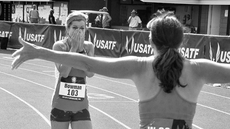 Becky Bowman, with a 14.15 windy 100, gets all-arms reception from W50 runner-up Amanda Scotti.
