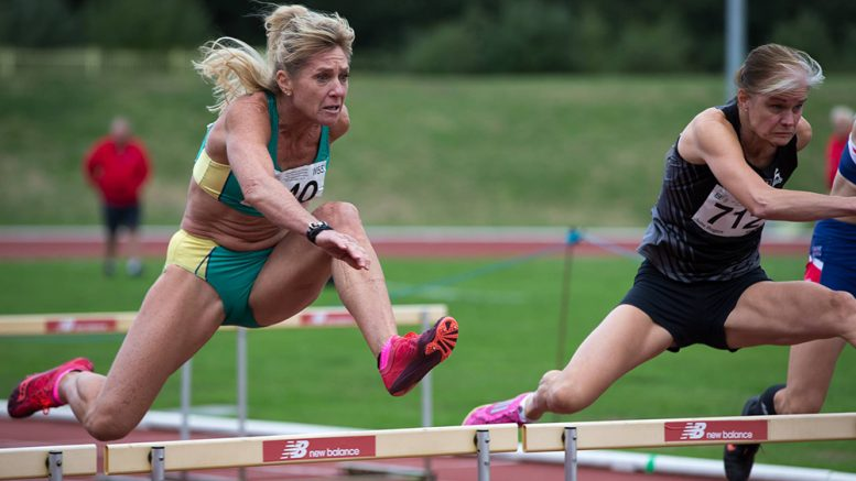 Australia's Michele Hossack (left) won the W55 80-meter hurdles in 14.03.