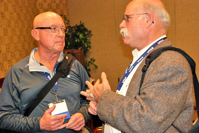 In 2008, George Mathews (left) and Jerry Bookin-Weiner chatted at the Reno annual USATF meeting.