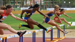 Yanelle (in long black socks) had the height advantage in Malaga but not speed, although she overcame another hurdler at end