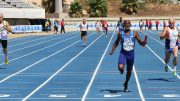Charlie Allie anchors America's gold-medal M65 4x100 relay team at Malaga.