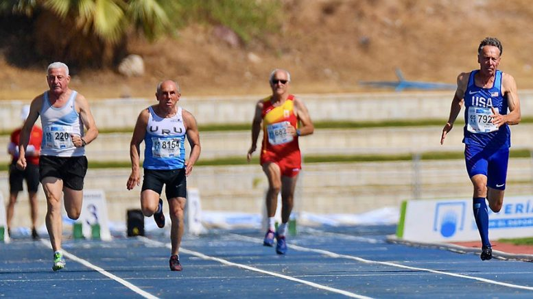 Michael Kish (right) leads Malaga heat in the M65 100. He won silver in final but wasn't on the 4x100 relay.