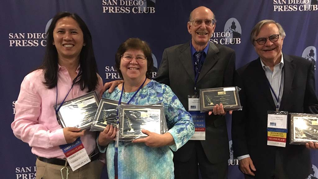 Chris and Ken (center) showed off their hardware (woodenware) at Press Club awards.