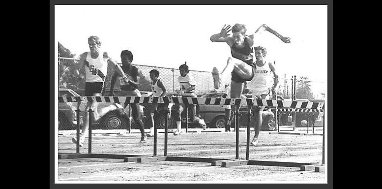That's me leading a 4x120 shuttle low hurdle relay — going against the barrier in 1970.