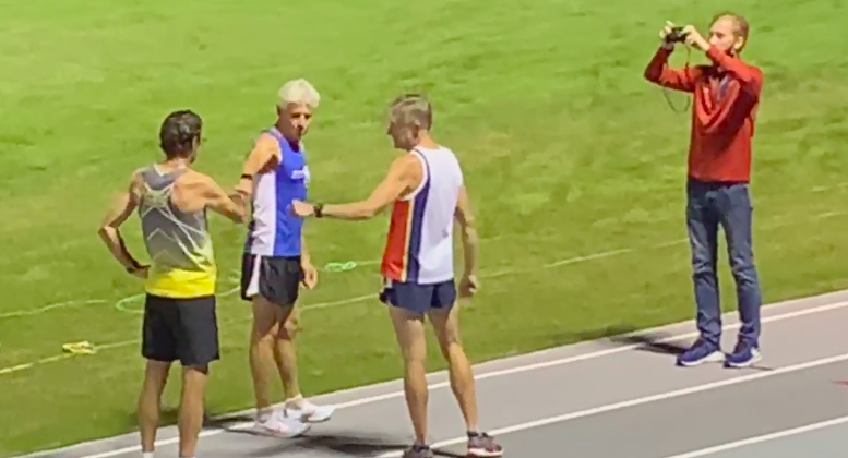 Dan King gets good-luck fist-bumps at start of Saturday's mile record attempt in Columbia, South Carolina.